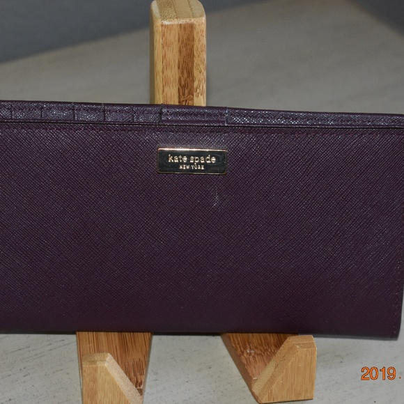Kate Spade Handbags - Kate Spade Plum Leather Stacy Wallet